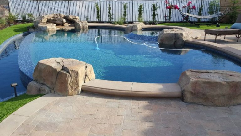 backyard swimming pool with landscape-Enciso's Pool Construction